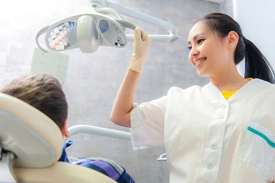 Dentist smiling at patient