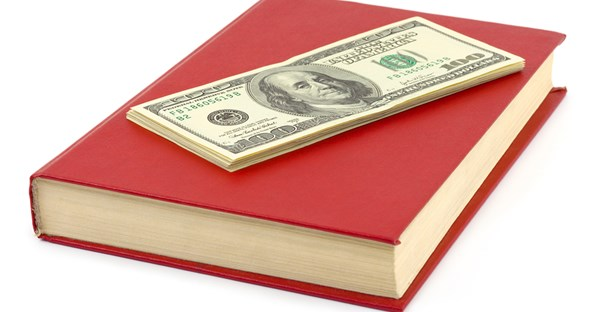 an image of money and a law textbook that will both be used for a juris doctor degree