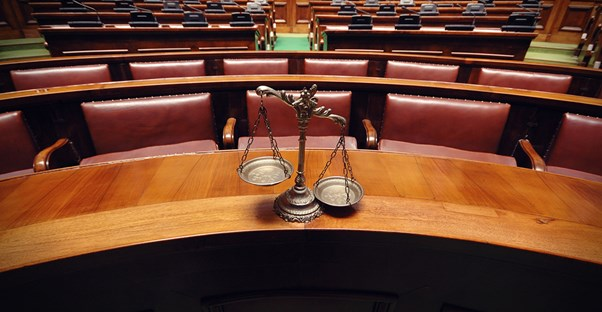 an image of scales in a courtroom that symbolizes the pros and cons of a juris doctor degree