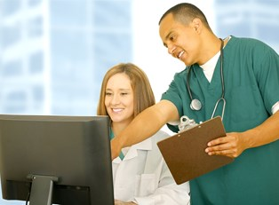 a medical assistant helping a doctor