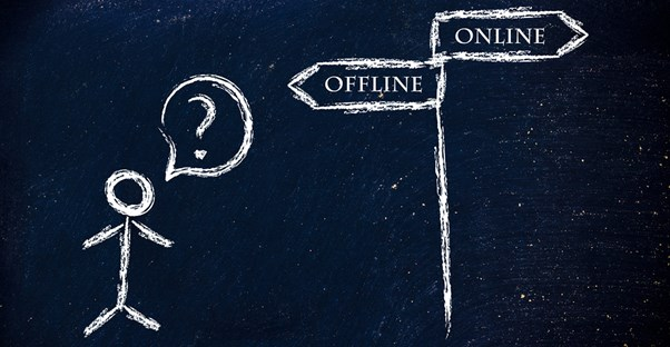 A stick man questions whether he should go in the direction of offline or online