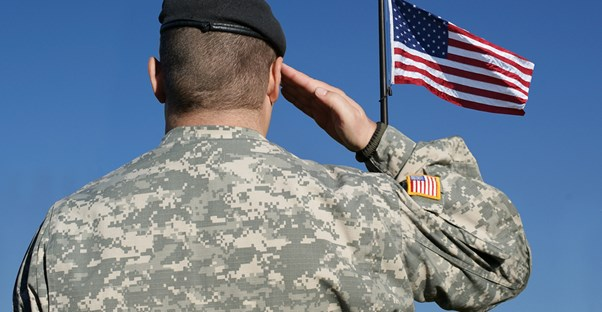 A soldier salutes the American flag