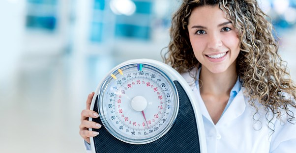 Nutritionist holds up a scale