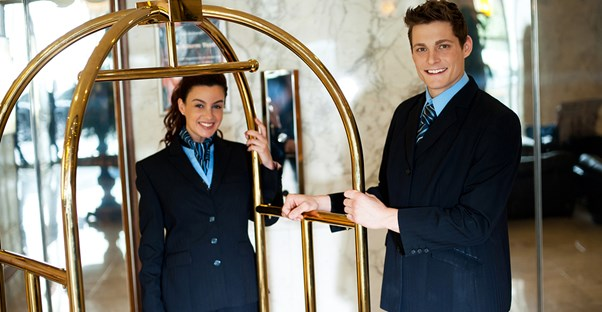 Hospitality managers play in a luggage cart