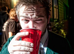 Frat guy drinks from a Red Solo cup