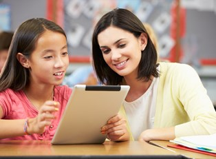 A tutor helps a student on a tablet