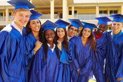 A group of high school graduates pose for a picture