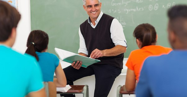 A teacher gives a lecture in his classroom