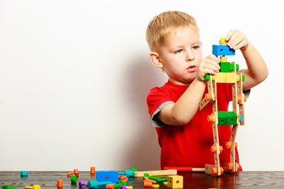 A young boy builds with blocks