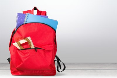 Backpack filled with notebooks and other school supplies
