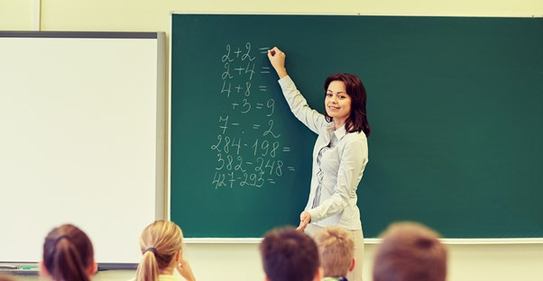 A teacher explains common core practices to her students