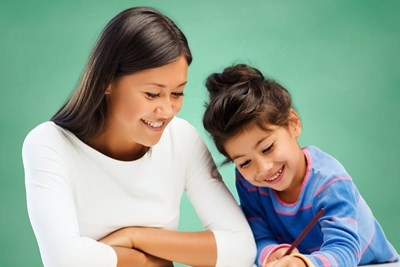 A special education teacher helps a student with homework