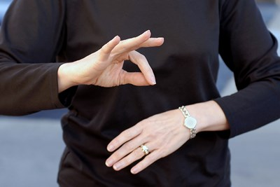 a woman communicating through learning sign language