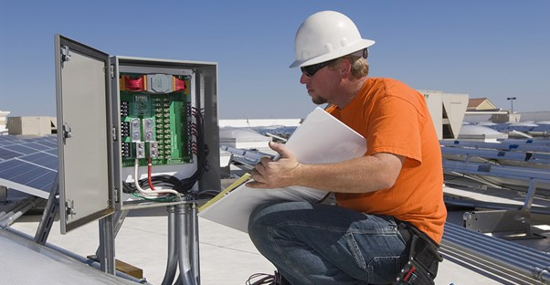 Electrical engineer working on a roof