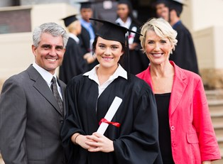 A college graduate poses for a picture with her parents